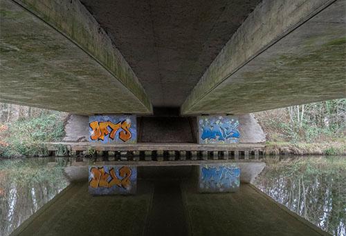 bridge over River Wey with graffiti