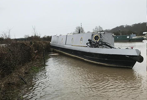 Grounded narrowboat on river Trent