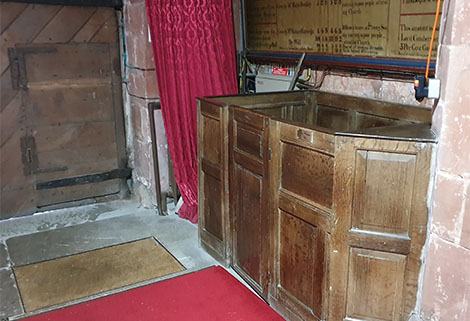 Interior of St Margaret's Church, Wrenbury showing dog whipper's pew