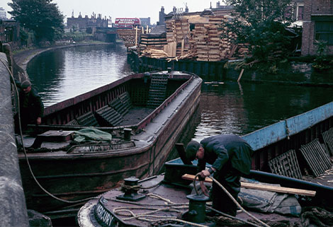 Boats turning at the Hertford Union Canal entrance having unloaded timber 1965, London Canal Museum