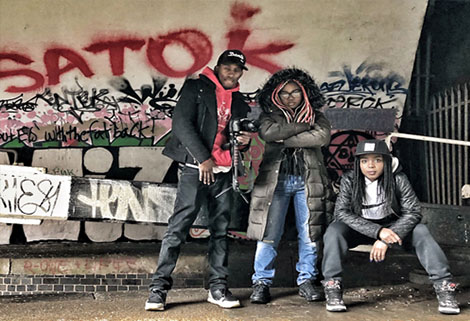 Rappers under bridge with graffiti