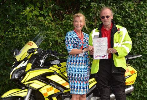Simon Woollen receiving Queen's Award for Voluntary Work